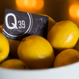 Q39 gift card in a bowl of lemons